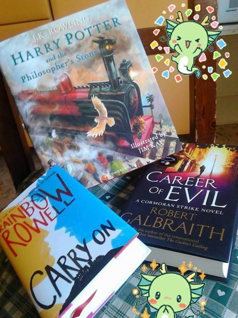 my hardcovers copies of HP illustrated ed. by Jim Kay, Career of Evil by Robert Galbraith and Carry On by Rainbow Rowell